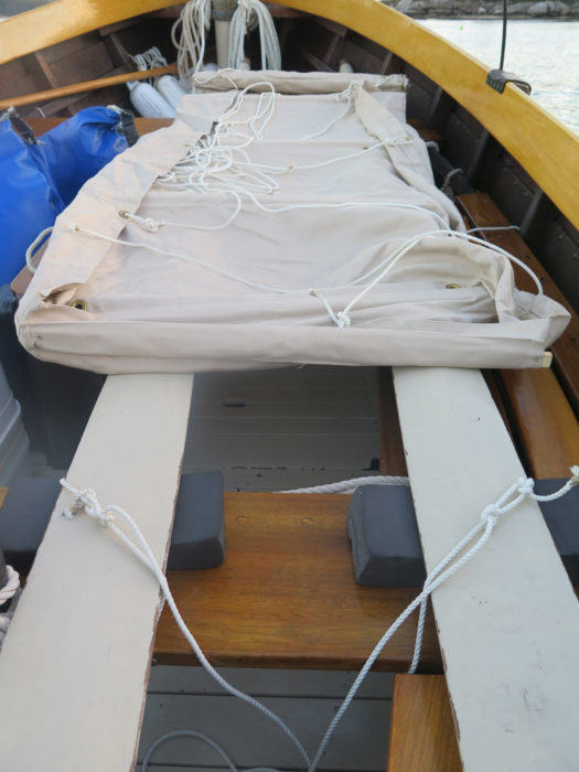 The canvas bunk rolls out over the oars. All lines remain with the bundle to hasten setup.