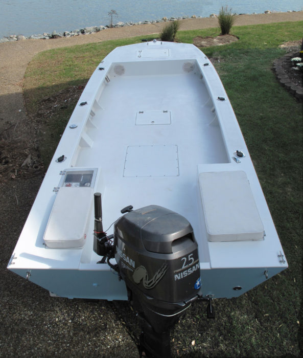 The interior is spare to keep the boat versatile. Sealed storage under hatches in the foredeck, sole, and the seat to port keeps gear out from underfoot. The starboard seat conceals a live-bait well.