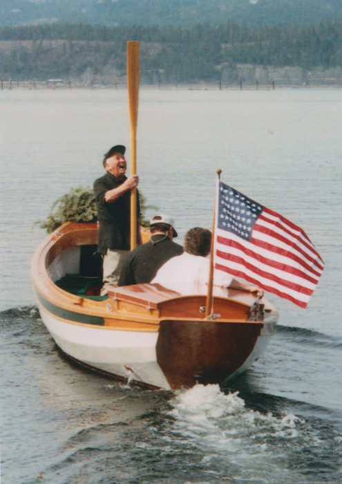 On launch day, with Rann at the helm and his mother Elsie Mae in the sternsheets, Art proudly took his place amidships. The ensign is one Samm had made to reflect the boat's origins circa 1900: It has 45 stars.