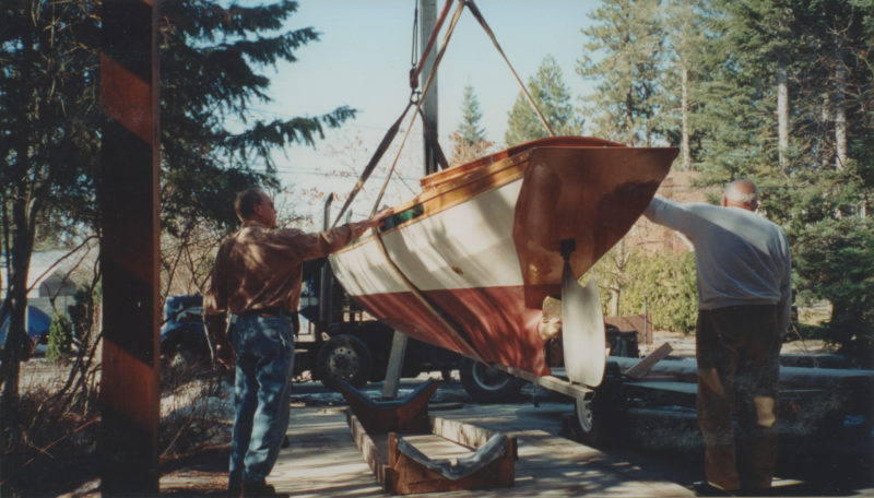 The dory's transom extends to the bottom; deadwood fixed to it supports the prop shaft. A stainless-steel skeg protects the rudder.