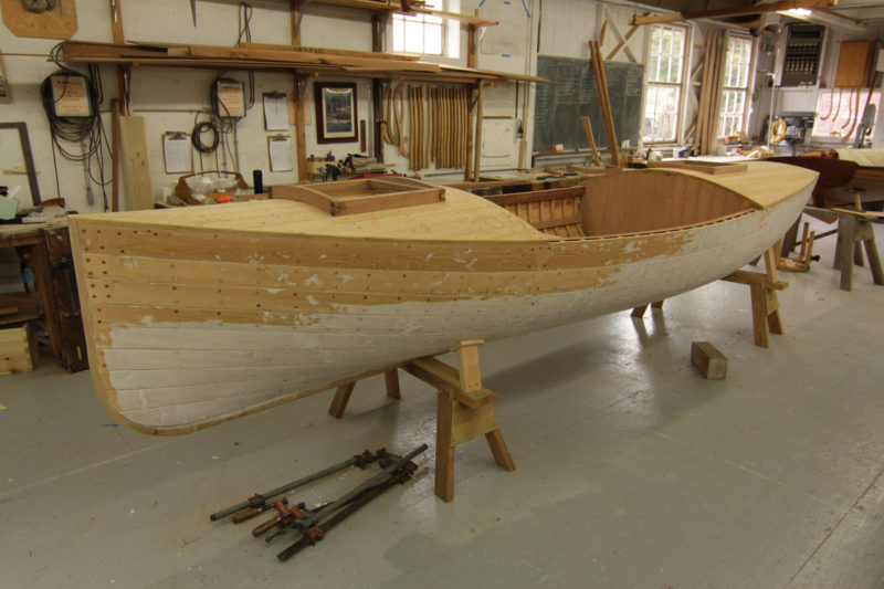 The scout boat's tongue-and-groove decking will have tarred felt stretched over it, followed by canvas and paint. A few screws await bungs. The scout boat had bronze screws and the large boats had galvanized screws; Powell's journals didn't mention the type of fasteners used in his boats.
