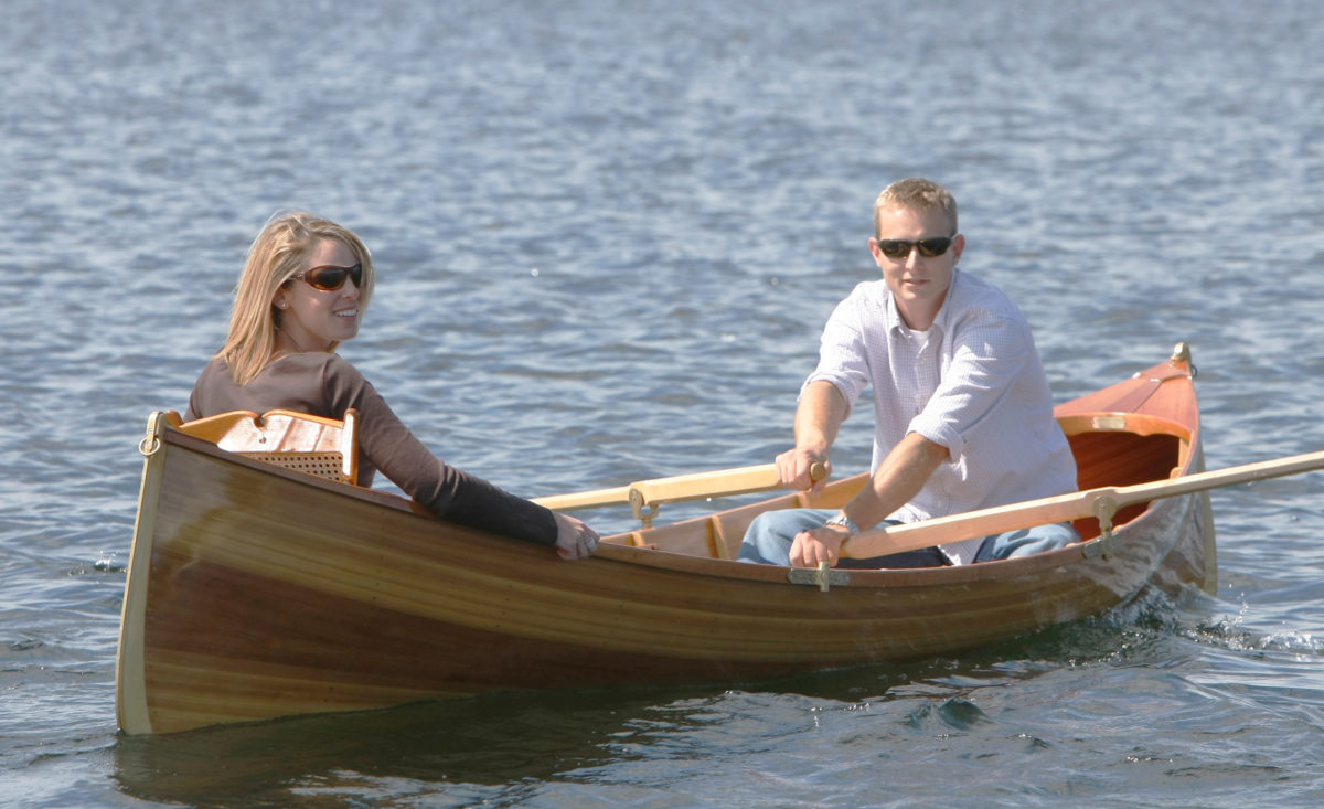 Guideboat builder Justin Martin takes Erin, his bride to be, out or summer row. She has her backrest up for comfort; Justin has his down for rowing.