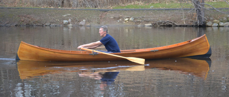 Paul Neil, in an early AGB guideboat built by Steve Kaulback, shows the rowing form that has taken him to scores of wins in rowing races.