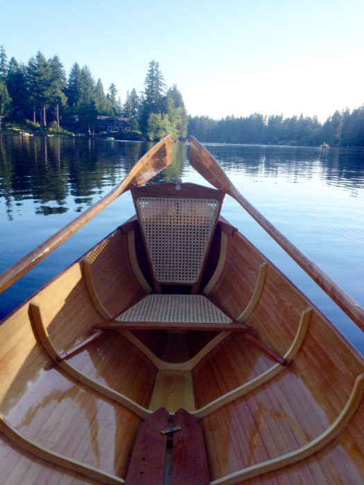The seat backs have horns at the corners to catch the oar blades when they're rested out of the water.