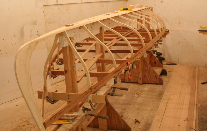 After the ribs are fastened to the bottom board, they're braced with cross spalls that establish the sheer line.