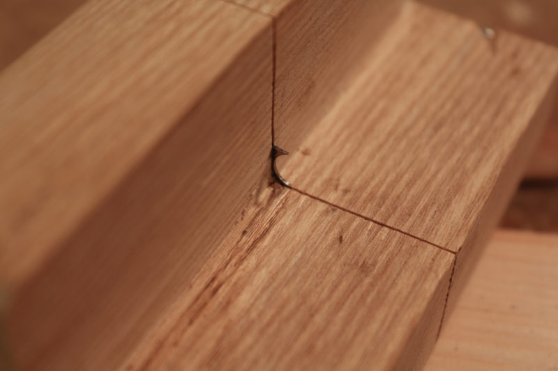 The simplest edge treatment is a corner bead, formed by a cutter with a half-round hollow and a sharp spur.