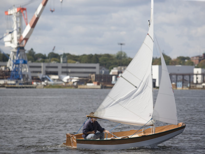 With a solo helmsman sitting in the stern sheets, the Passaagemaker will settle down by the stern. Sitting on the bottom farther forward or carrying ballast in the bow will restore proper trim.