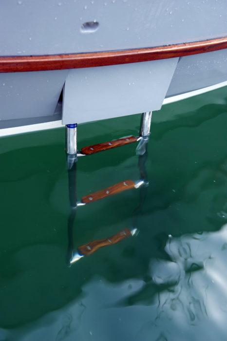 A retractable swim ladder is built into the starboard side of the hull at the aft end of the cockpit.
