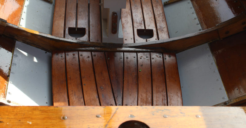 The heel holes in this Chamberlain gunning dory's floorboards have an extra cleat to keep the corners of the cutouts from splitting.