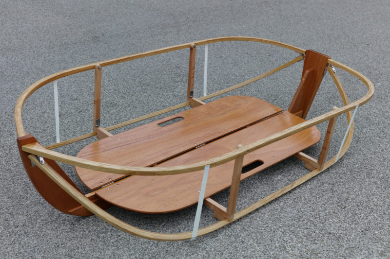 The chines and gunwales meet the stem at an angle and require small triangles of wood to accommodate the hinges.