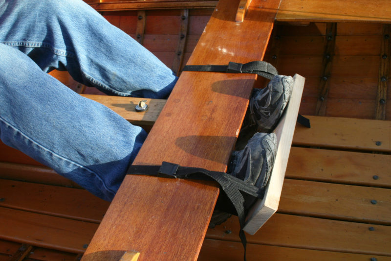 Two straps and a simple footboard with four slots for the webbing make a trapeze stretcher.