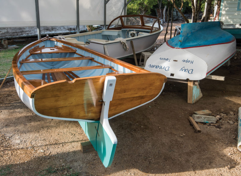 Sculling is a common in the Bahamas and the Abaco skiffs often have sculling notches in the transom instead of oarlocks or tholes on the gunwales. The notches are set to port and the sculling is done left handed, freeing the right hand for other tasks.