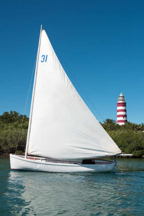 "Howard Chapelle notes ""The Bahama sail is always made long on the foot and not excessively lofty. This, with the heavy roach at the foot, brings the center of effort low by modern standards for a triangular sail."""