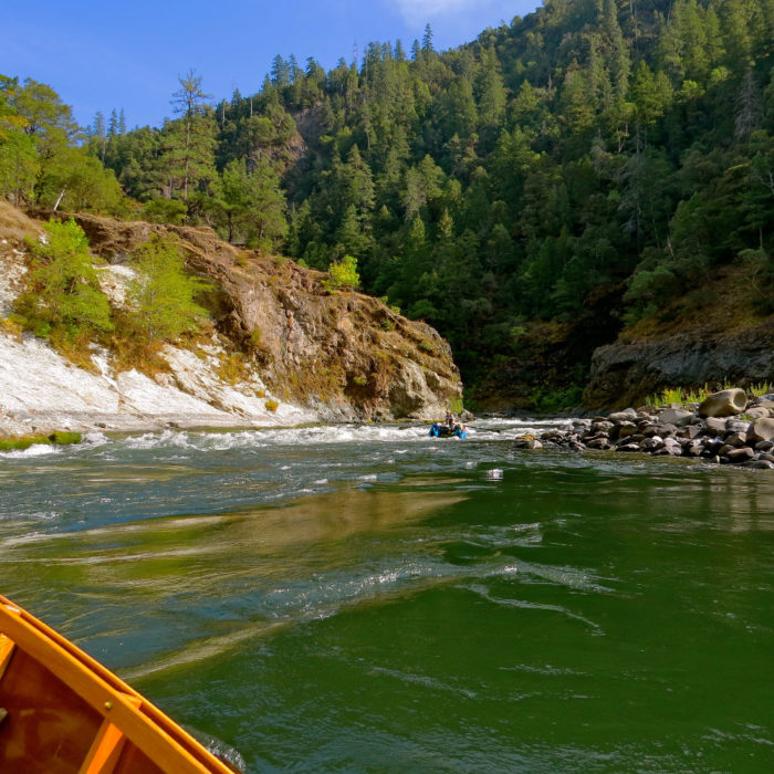 The Class-III Devils Staircase was one of the few rapids we found a little easier in low water; it was a slip-and-slide run of moderate waves. I pulled into the peaceful eddy on river left to watch the rafts come through after me.