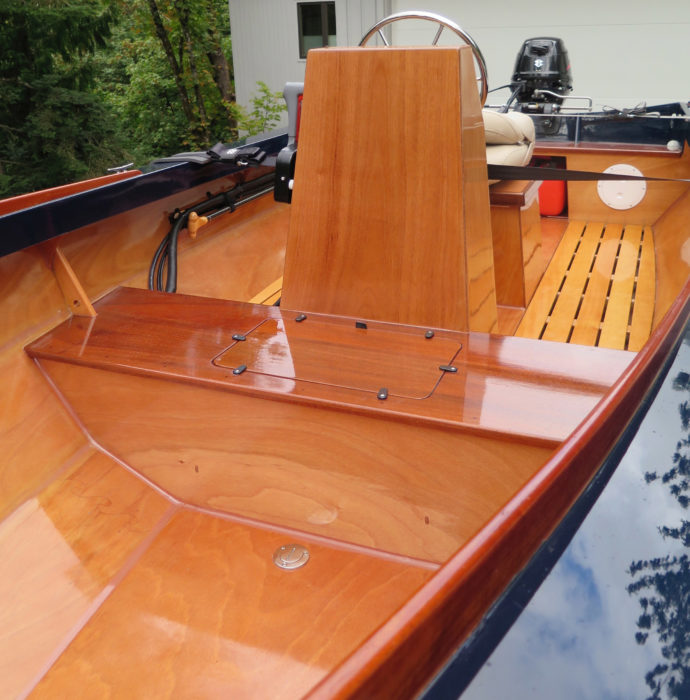 Mark replaced the kit's plywood seat tops with solid sapele, cut them slightly oversize for a visually appealing overhang and wrapped the tops and bottoms with 4-oz 'glass. The middle seat also has reinforcing gussets port and starboard where passengers are likely to step aboard.