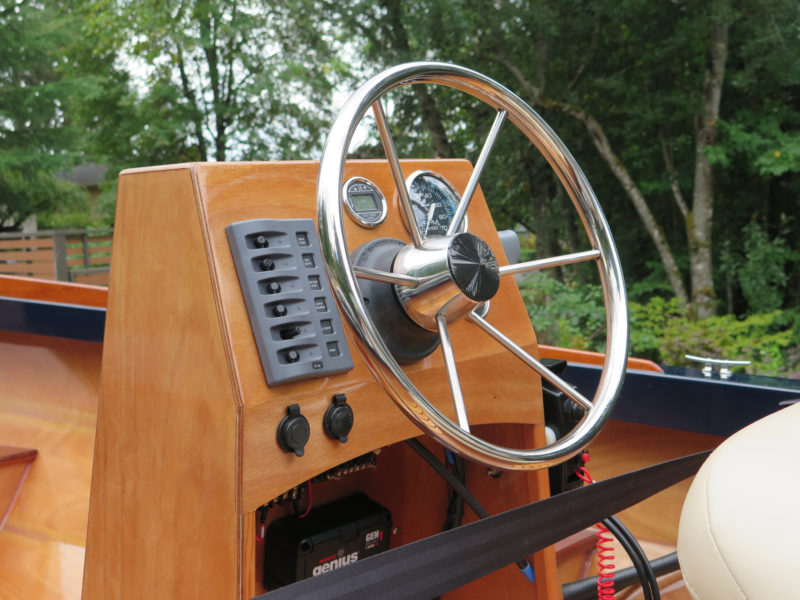 The instrumentation mark added to his PT Skiff includes tachometer, voltmeter and depth sounder with through-hull transducer. In the open space beneath the console he has an onboard 120-volt charger for charging the 55A/H AGM battery under middle seat.