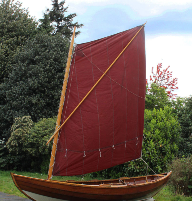 A loose-footed spritsail is brailed with a grommet or ring on the leech.