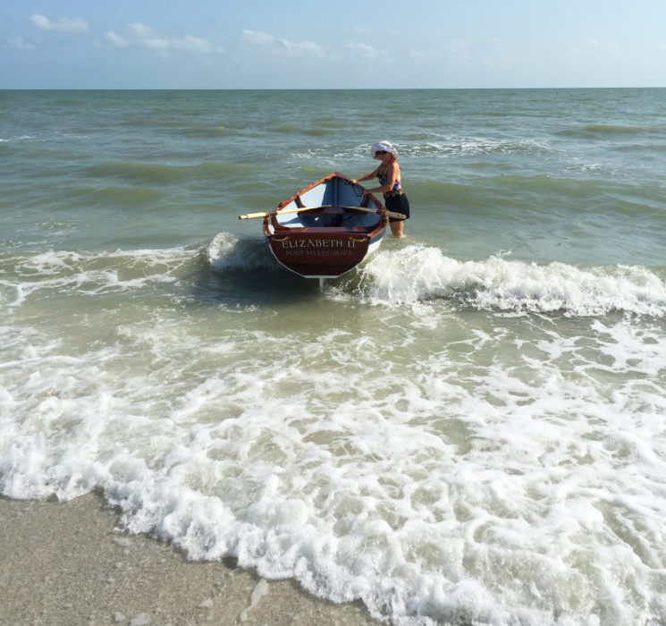 The waters on the Gulf coast are not always calm, but the dory can easily manage a bit of surf. Here Courtney holds the boat, waiting for Doug.