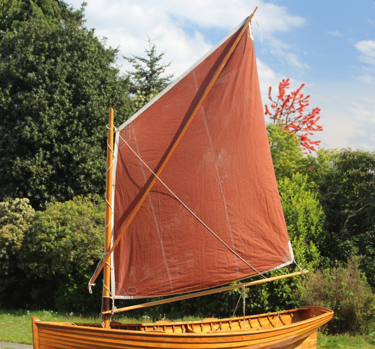 For a spritsail with a boom, the brail slips under the boom.