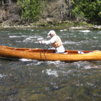 Stout ski poles offer a way to moveupstream in the shallows while kneeling rather than standing in a canoe.