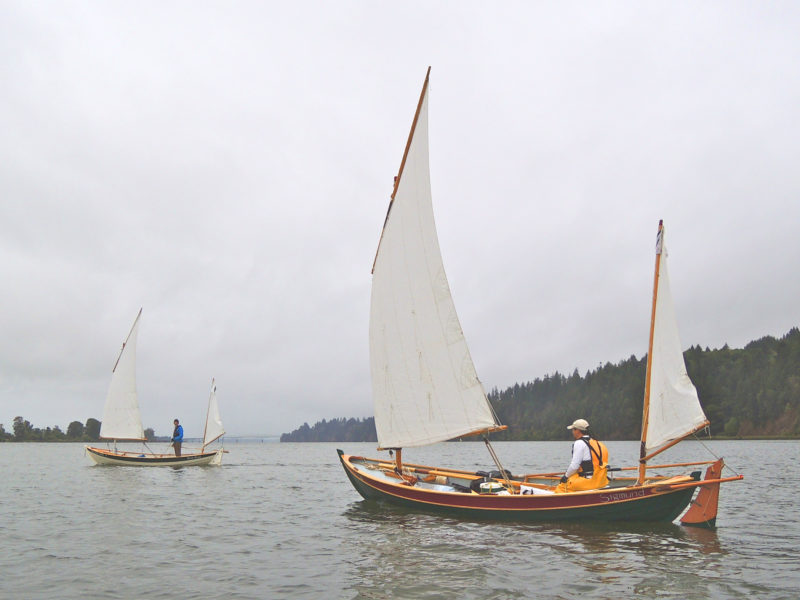 The author's Arctic Tern, ROW BIRD (left), and SIGMUND, owned by Andy McConkey, the builder of both boats, sail out of Portland, Oregon. Both cruise the inland waters of the Pacific Northwest.