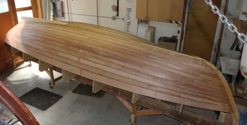 Hull #2 is under construction in Eric Hvasloe's shop. The planking is laid over an inner keel and stem assembly, then bevelled to receive the external elements.