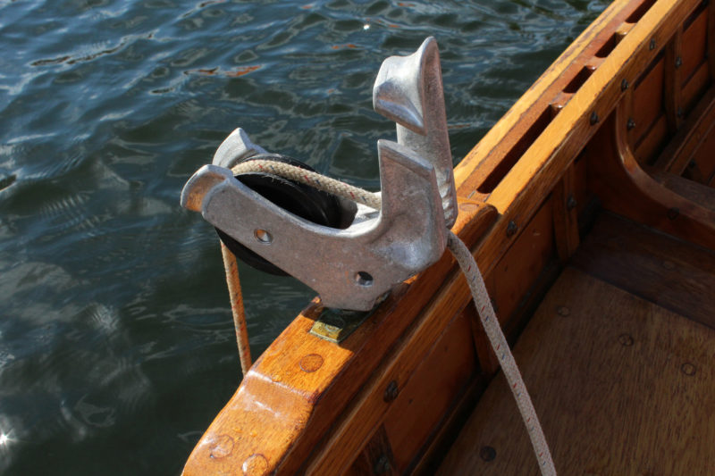 The Pocket Puller holds line clear of the gunwale, preserving the finish. The fairlead and jam cleat allow for one-handed operation.