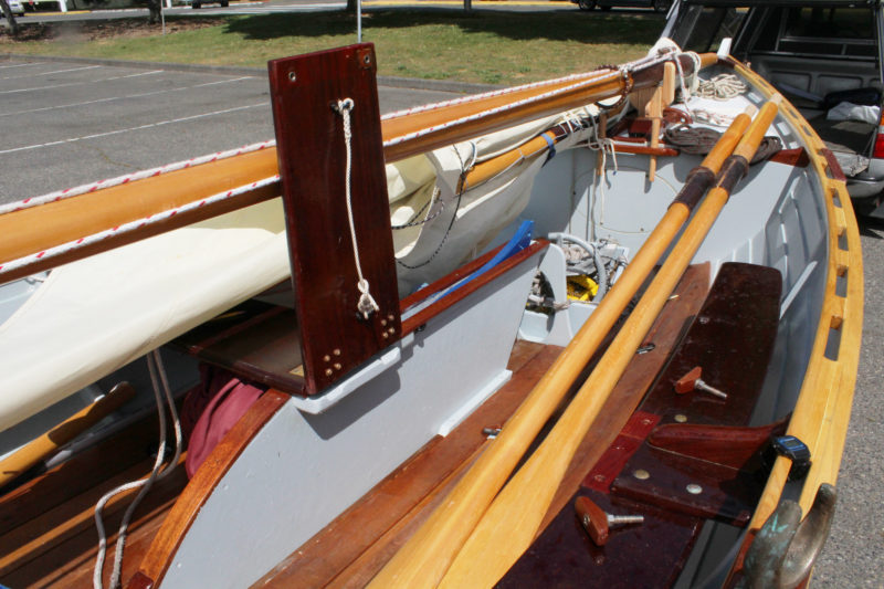Tim modified the thwart, outfitting a section of it with sturdy hinges, open up a space for sleeping aboard.