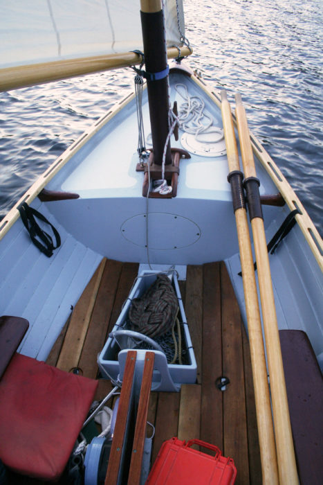 You don't have to hold eh mainmast fully upright to get it stepped. The elongated box guides the heel in; then you can push the mast upright and lock it into place.