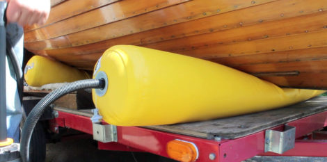 I didn't know if the pump handle the air pressure required to lift the boat, but it became evident that the weight, say 200 pounds, would be divided by the contact area, say 20 square inches at the full lift, to bring the pressure down to 10 psi.