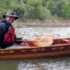 Dave made paddles for the canoe and decorated them with the same insignia he put on the canoe. He and his friend Andy Look won the wooden canoe division of the 13.5-mile Abe's RIver Race on the Sangamon River in Illinois