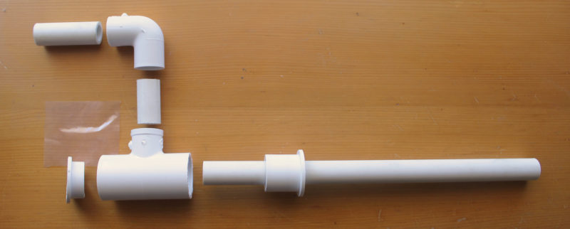 The parts are common plastic pipe and fittings. Only the two reducers need modifying: The one at the back of the horn (left) is shortened and the one at the front reamed out to let the pipe slip through.
