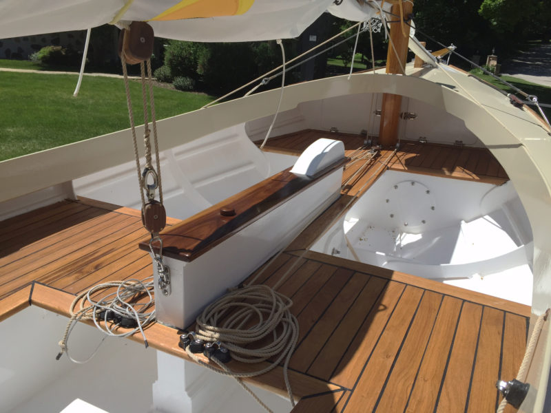 The control lines are lead aft along the centerboard trunk for easy access while solo sailing. The decking covering the plywood seating is a personal touch by the author. The spaces under the foredeck and seats provide ample room for stowing cruising and camping gear.