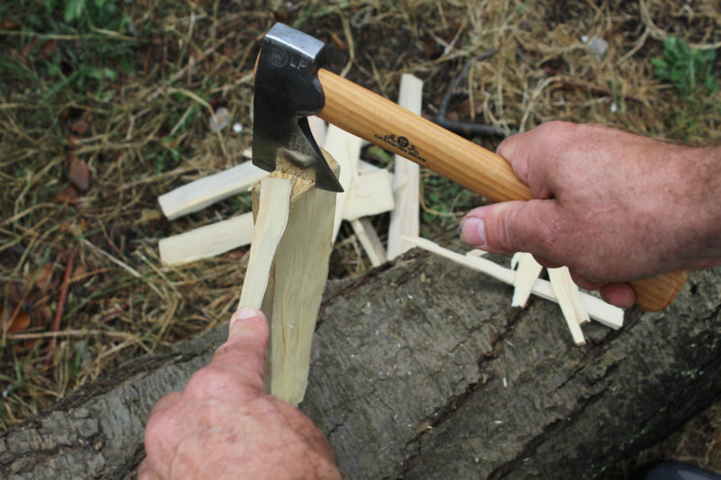 The Small Hatchet is a great tool for splitting kindling. Using a stick to keep the workpiece upright keeps the fingers at a safe distance from the sharp blade.