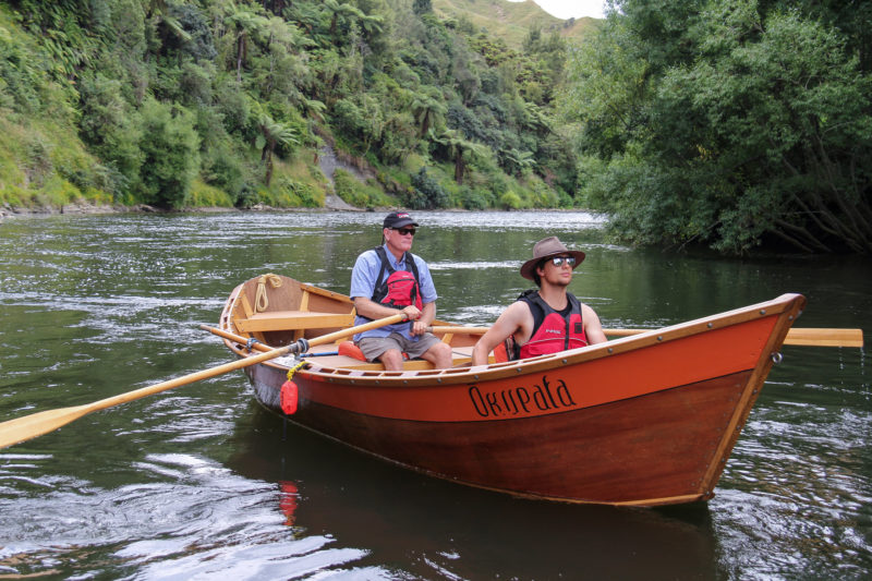The dories enter their career of professional servitude on the Whanganui River amid a jungle of tree ferns and waterfalls.