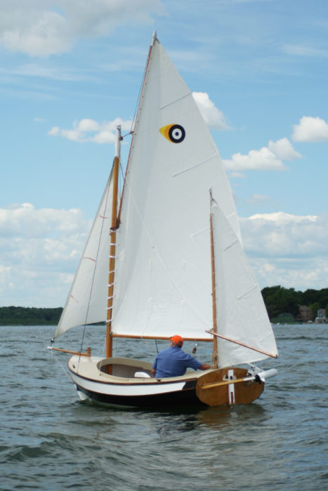 The gaff yawl rig has a 28-sq-ft jib. an 88-sq-ft main, and 21-sq-ft mizen. The insignia on the main is the author's personal mark for his Navigator, PUFFIN.