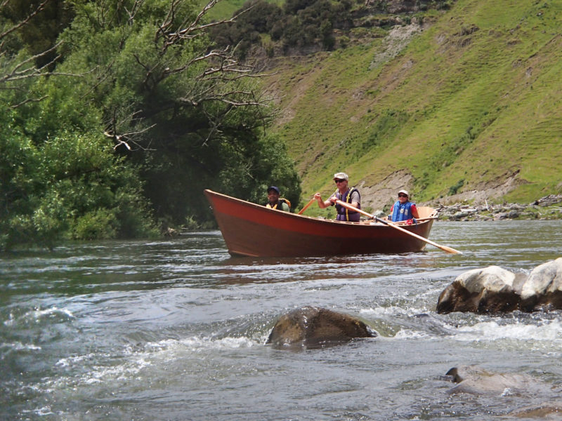 Andy Hutchinson recognized the familiar feel of a Briggs boat entering a rapid on the Whanganui River. Oregon drift boats like these are rowed with the boatman facing the high prow, which is, technically, a highly evolved stern—and transom behind the boatman is a truncated bow.