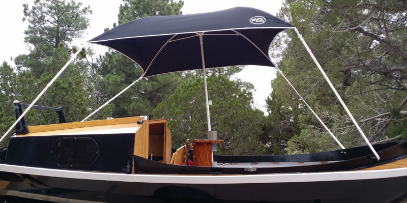 Nate rigged an umbrella for protection from the merciless Arizona sun. This square one with straps on the corners is designed for use on boats.