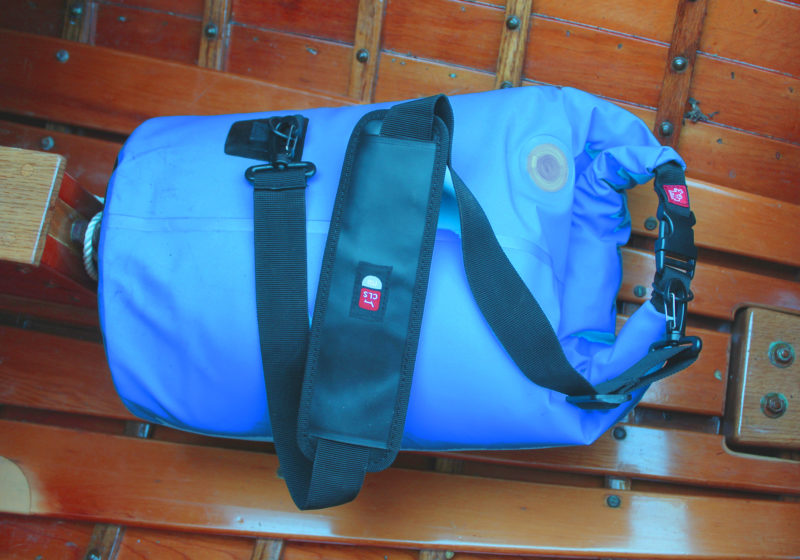 A shoulder strap frees up your hands to carry other things. The valve near the top of the bag allows you to add air to the interior layer of insulation to help trap cold and deflate the bag to roll it up for storage.