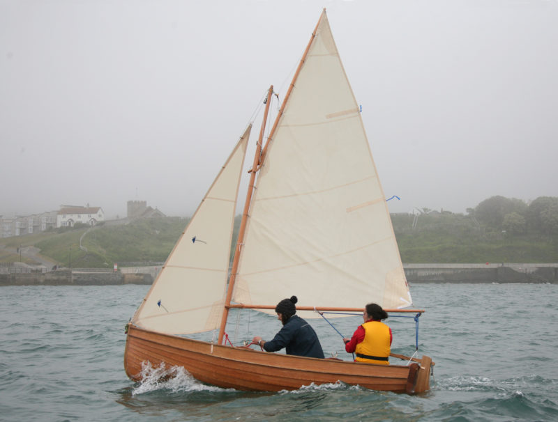 The sloop rig here carries 72 sq ft of sail. The plans include options for single sails: a balanced lug rig, with boom, carrying 64 sq ft of sail; and a standing lug, loose footed, carrying 55 sq ft.