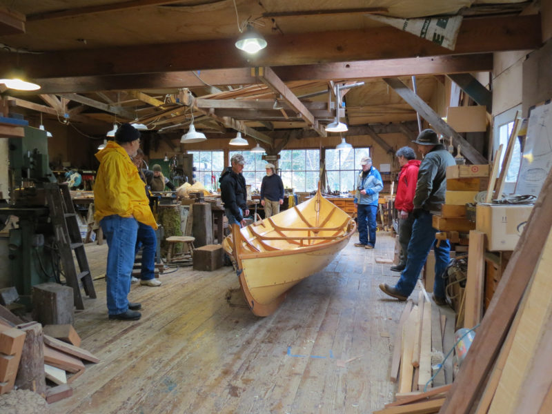 All hands are ready to assist as the new boat is taken off her blocks and freed from her overhead shoring beam.
