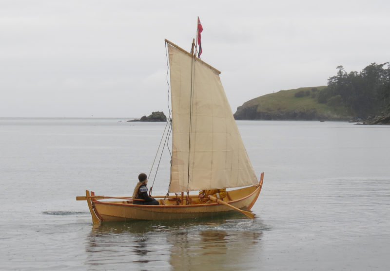 Leah is at the helm for TJÆLD's maiden voyage at Bowman Bay on Fidalgo Island.