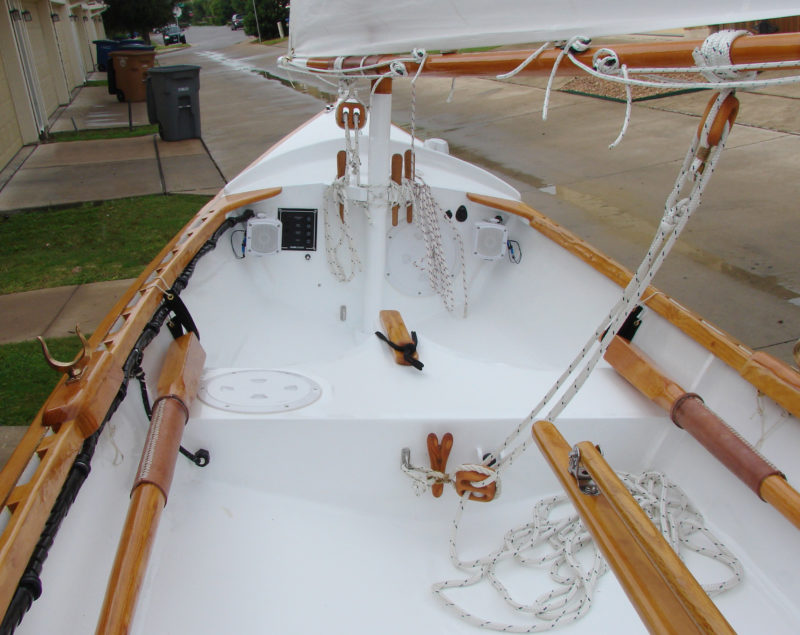 The configuration for the balance lug rig, seen here, has one rowing station. The gaff rig configuration has a second forward rowing station forward and a low flotation tank instead of a foredeck.