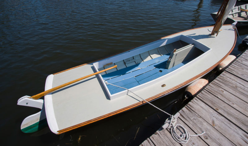 For sailing, the floorboards provide seating; a removable bench was used for rowing. This skiff's oarlock sockets are made from pipe and extent to a cleat spanning a pair of frames. The arrangement accommodates the strain imposed by the tall oarlocks. The decked over forward area makes for a great place to stow a cooler, a beach towel, a pair of binoculars, and a paddle.