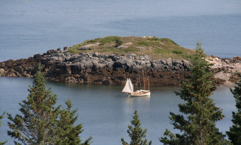 The view from Montserrat Hill took in WAXAING and SLIPPER anchored next to The Nubble, a rock outcropping at the easternmost point of Butter Island. Tides are commonly 10-12 feet along this part of the Maine coast. The boats are on a modified Pythagorean mooring to keep them afloat and off the beach, but easily retrievable.