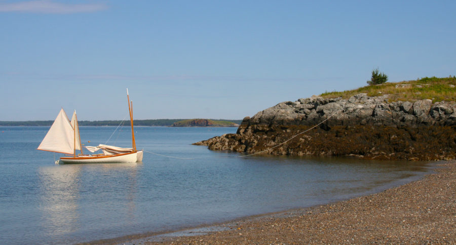 At Nubble Beach on Maine's Butter Island, the tide exposes several hundred feet of beach at low ebb. Here, the anchor was set just beyond the low tide mark, and the extra warp was walked out the rocky promontory to secure the boats. With this adaptation of the Pythagorean system, the boats can be pulled into water even deeper than it is where the anchor is set.