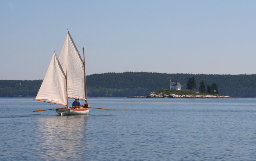 In a light breeze Rob row-sailed toward Pumpkin Island and the top of the Eggemogin Reach. Sail-assisted rowing made it possible to cover mileage more effectively when sail alone would have been too slow to keep the pair on schedule to make good use of the tidal currents around Penobscot Bay.