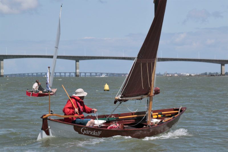 Emmanuel, a professional boatbuilder, had fitted an automatic line reefing system on his Grand Skerry design. Here the fleet is beating toward the bridge spanning the mouth of the Seudre river. The bridge in the distance connects Oléron Island to the mainlad