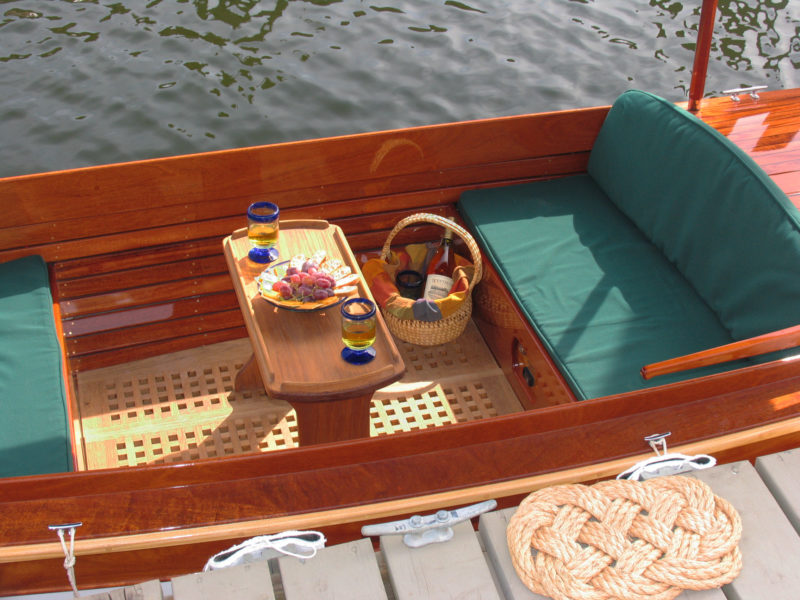 The optional teak-grate sole and the folding table make for a well-appointed cockpit.