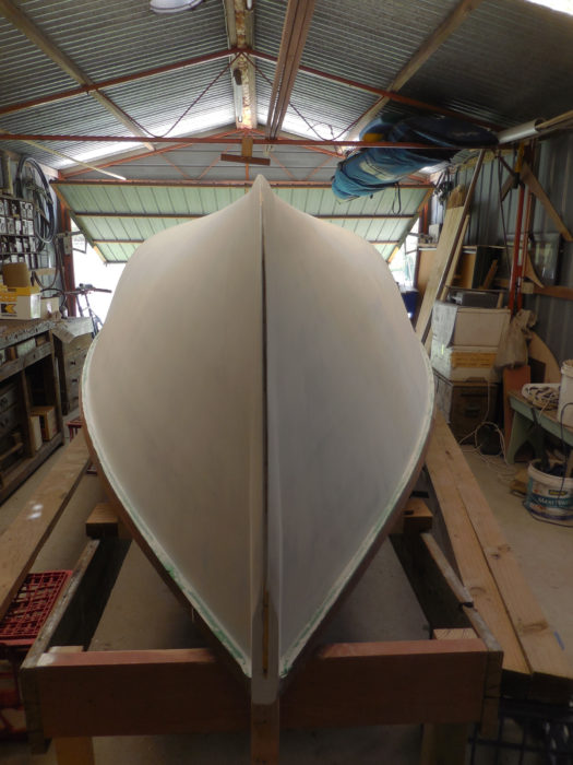 The strip-built skiff is lighter than its lapstrake predecessor and the interior, without laps and frames, is just as smooth as the interior and easier to finish and maintain.